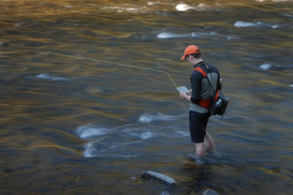 Alex choosing flies to fish Rock Creek